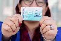Person holding a Long Beach Public Library Card